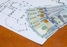 Money on house plan Stock Photography