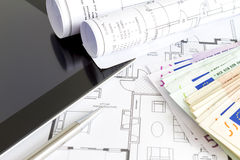 Money and house plans stock images