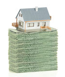 House and stack of dollars Stock Photography