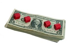 Money and houses. Bills pile and houses Stock Photo