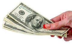 Money in human hand. Female hand giving money isolated Stock Photo