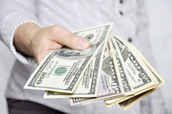 Money in human hands Royalty Free Stock Photos