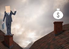 Money icon and Businessman standing on Roofs with chimney and cardboard box on his head and dramatic. Digital composite of Money icon and Businessman standing on royalty free stock photography