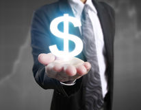Money icon in hand. Money concept stock photo