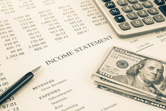 Money and income statement report in sepia tone Stock Photos