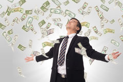 Money increase .Businessman happiness Stock Photo