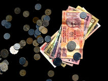 Money in India. Indian notes and coins on a black background Royalty Free Stock Photo