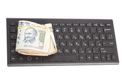 Money Indian Currency Rupee Notes on computer keyboard Royalty Free Stock Photography