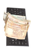 Money Indian Currency Rupee Notes on computer keyboard isolated Stock Photos