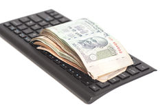 Money Indian Currency Rupee Notes on computer keyboard isolated Stock Photo