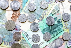 Money from Indonesia, rupiah banknotes and coins. Royalty Free Stock Images