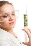 Money injection. Young woman hold syringe with dollar inside stock photos
