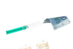 Money and injection Stock Photos