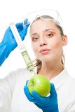 Money injection into business. Woman and syringe with dollar in green apple, isolated on royalty free stock photo