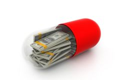 Money inside a capsule Royalty Free Stock Photography