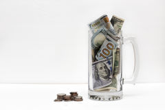Money Inside and Outside. A jar with bank notes and a coin's pile beside Stock Image