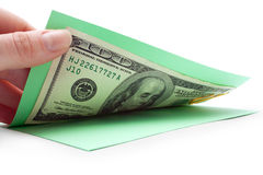Money inside postcard, opening by hand Stock Photography