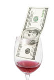 Money inside wine glass Stock Images