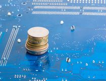 Money from Internet. Coins over technological background stock image
