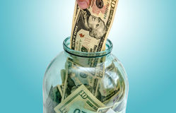 Money is invested in a glass jar Stock Photos