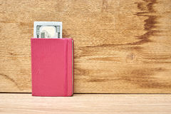 Money invested in the notebook Royalty Free Stock Images
