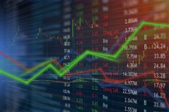 Money Investing and stock market concept gain and profits with faded candlestick charts. royalty free stock images