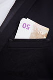 Money in jacket pocket Royalty Free Stock Images