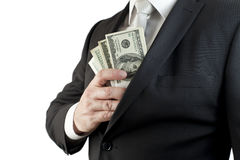 Money in the jacket. A well-dressed man put money in the jacket Royalty Free Stock Images