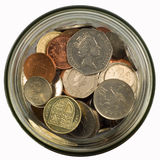 Money in a jar. Money in a glass jar isolated on white Royalty Free Stock Images