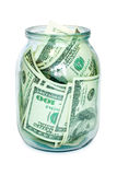 Money in the jar. Isolated on white royalty free stock image