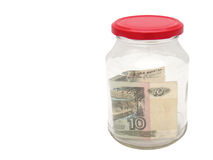Money jar. Glass jar with 10-rubles bill inside stock image