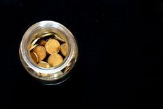 Money jar. Glass jar filled with coins (euro royalty free stock photography