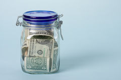 Money in jar Royalty Free Stock Image
