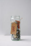 Money jar with australian money and the note shoes Stock Images