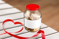 Money jar. Coin ngo heart euro full concept royalty free stock photography