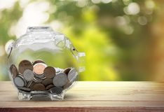 Money Jar with coins on light background royalty free stock photography