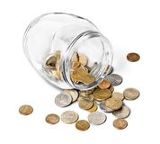 Money Jar with coins on white background royalty free stock photo
