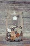 Money jar with coins Stock Images