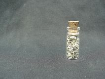 Money in a Jar with a cork. One dollar in pieces inside a small jar covered with a cork Stock Image