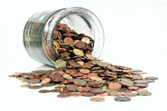 Money jar with Euro coins. Glass money jar full of Euro coins isolated on white stock image