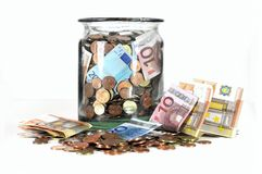 Money jar with Euro currency. Glass money jar full of Euro banknotes and coins isolated on white