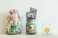 Money in jar euro dollars bitcoin Royalty Free Stock Images
