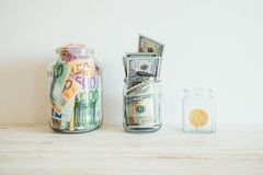 Money in jar euro dollars bitcoin Royalty Free Stock Photography