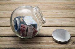 Money in a jar. Money in a glass jar, saving concept or donation Royalty Free Stock Photo