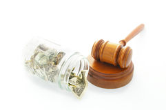 money jar and legal gavel Royalty Free Stock Photo