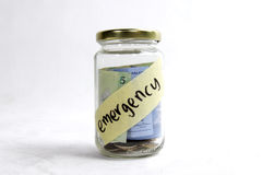 Money in jar ready for emergency Royalty Free Stock Images