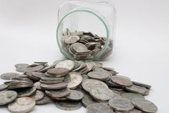 Money jar spill Stock Image