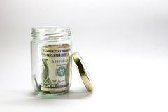 Money in the jar. On white background royalty free stock photos