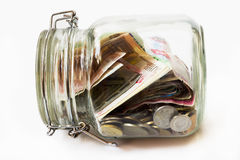 Money jar, white background Stock Image