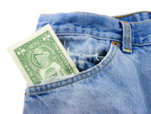 Money in Jean Pocket. Concept of poor - US one dollar bill money sticking out of a torn blue denim jean pocket, isolated on white with clipping path Royalty Free Stock Image